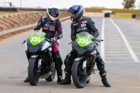Motorcycle racer, International American Latin dancer and Head Veterinarian, Dr Laura Brown of Sydney, discussing racing tactics with mentor and racing Team Manager, Warwick Nowland of Warwick Nowland Racing, during BCperfomance's Open Track Day at Mallala Raceway, Thursday, May 19, 2016.