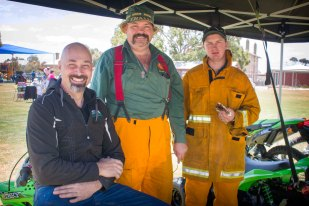 SA Motorcycles CEO, Evan Byles of Tailem Bend chatting with Tailem Bend CFS members Michael McEntee and Tim Reynolds both of Tailem Bend during the Tailem Bend Primary School Fete, Saturday November 5 at Murray Street, Tailem Bend.