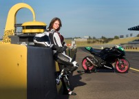 Head Veterinarian Dr Laura Brown of Sydney, soon of Tailem Bend, with her new Ninja 300 race bike at the Sydney Motorsport Park, Eastern Creek, New South Wales.